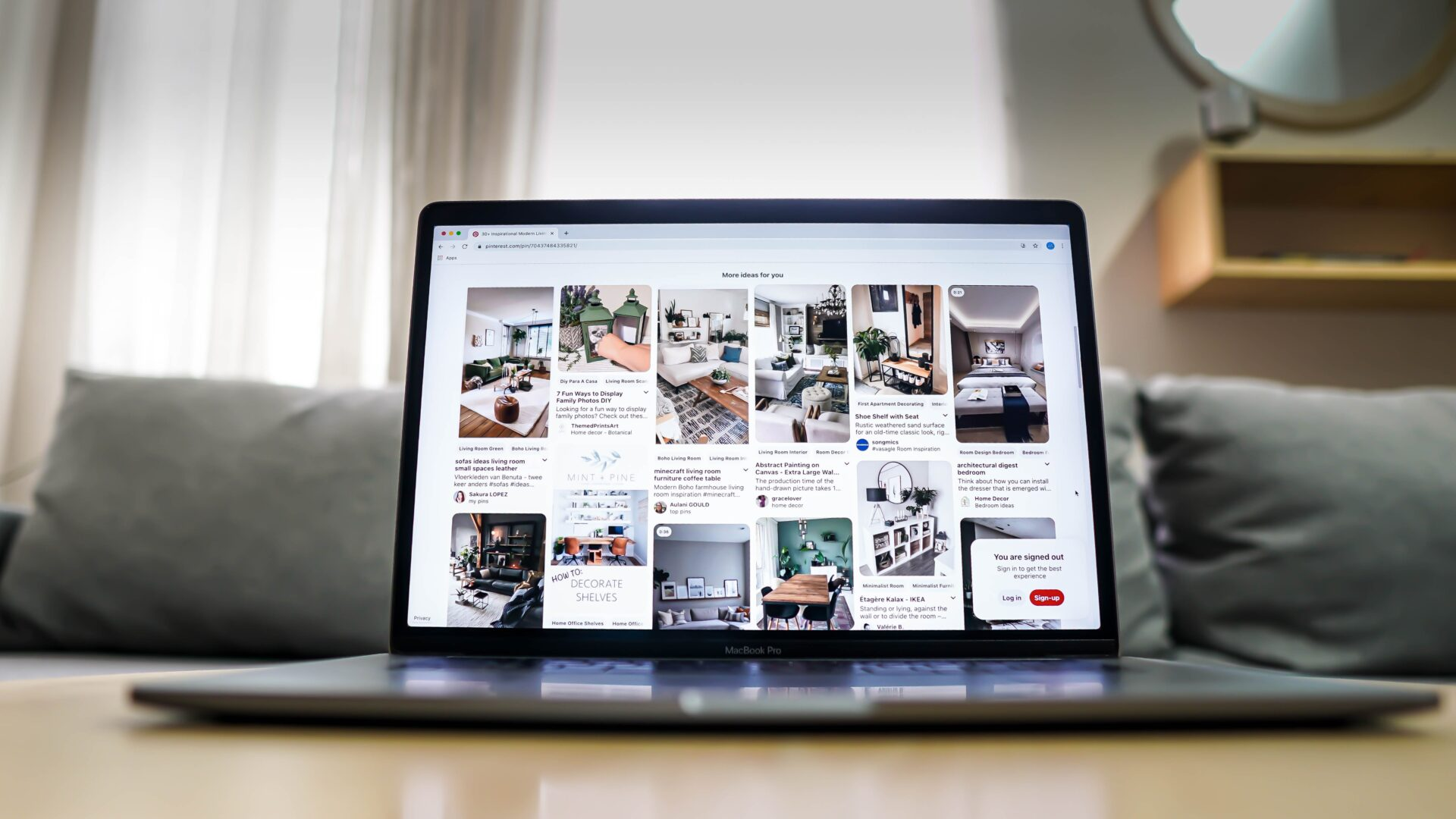 a laptop with pinterest homefeed opened